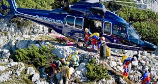 Italian cave rescuers leave a helicopter after being brought to the entrance of the Riesending-Schachthoehle cave at the Untersberg near Marktschellenberg, southern Germany on June 18, 2014. A 52-year-old explorer trapped with a serious injury in Germany's deepest and longest cave is transported by rescuers from Germany, Switzerland, Austria and Italy. AFP PHOTO / DPA/ NICOLAS ARMER   GERMANY OUTNicolas Armer/AFP/Getty Images